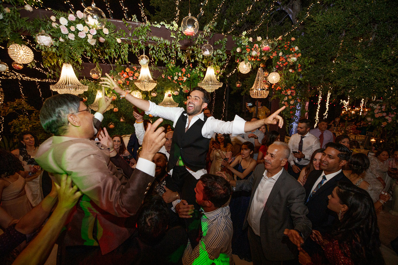 Husband dancing during the reception party of an Indian Wedding
