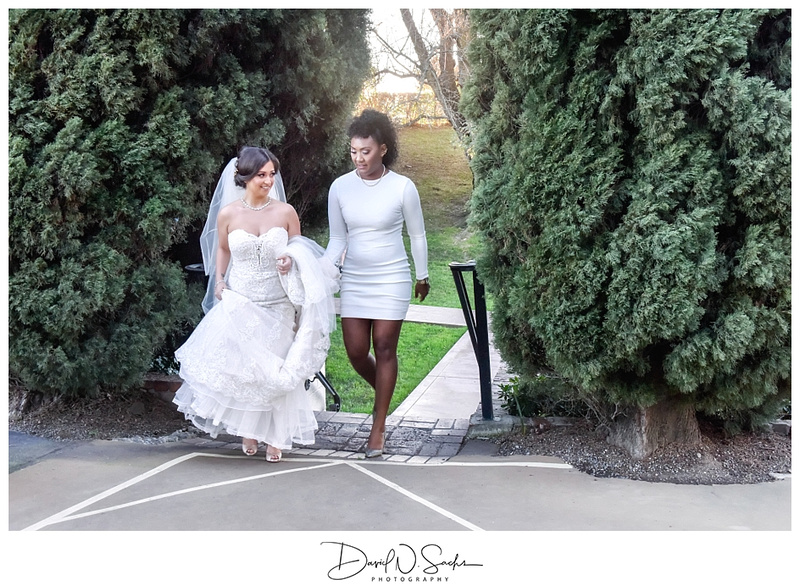 Multicultural LGBTQ brides walking toward their wedding reception.