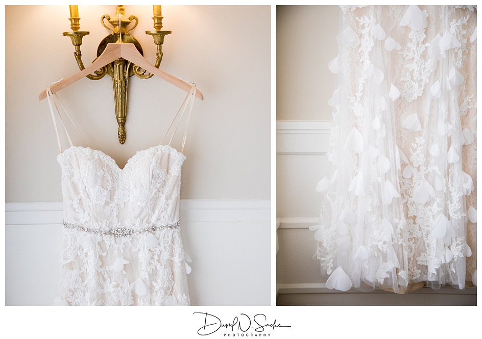 Two close up images of a vintage style wedding dress hanging in a hotel hallway.