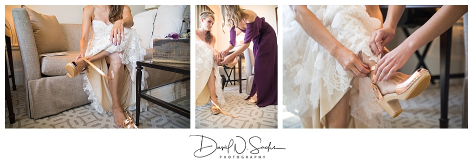 A bride puts on her shoes in a hotel room prior to her San Francisco City Hall wedding ceremony.