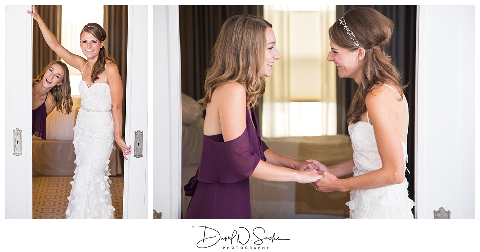 A bride takes cute candid photos with her sister at Hotel Drisco.