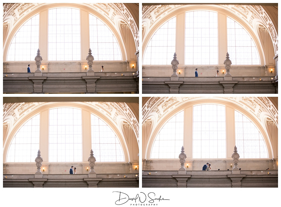 Four frames show a couples walking towards one another on a balcony at SF City Hall.